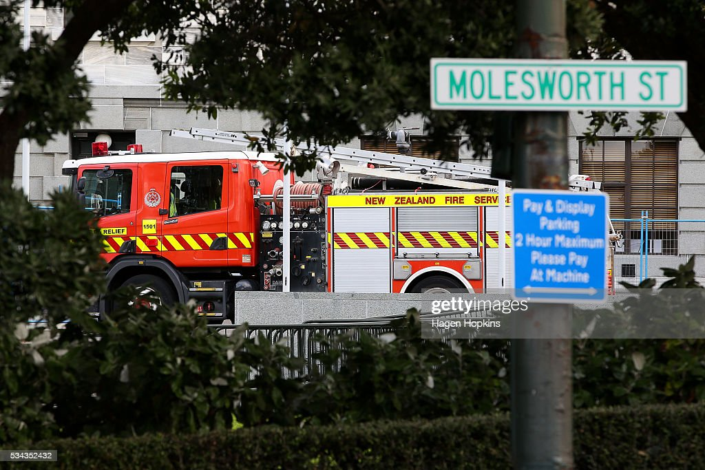 A fire truck sits on the forecourt of Parliament following an incident at Parliament on May 26, 2016 in Wellington, New Zealand. Police have blocked off the Parliamentary forecourt and the front entry point because of a truck stationed outside the Beehive, and have taken a man into custody following the incident on Thursday morning, the day of the national Budget release.