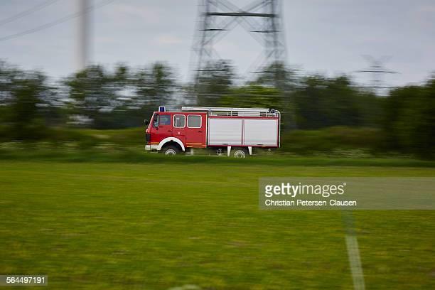 Fire Truck speeding along rural road