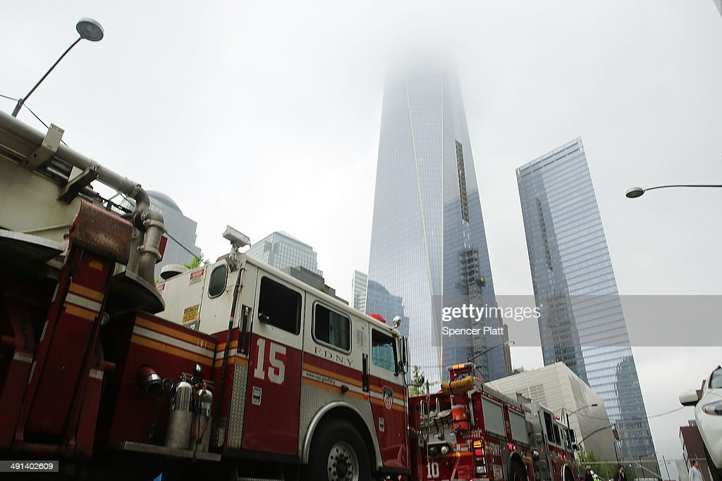 Fire trucks are viewed just outside the ground zero memorial site after authorities opened the plaza to the public free of charge on May 16, 2014 in New York City. Prior to today, visitors had to wait in line to enter a barricaded area which includes the newly dedicated National September 11 Memorial Museum. Together with the museum, Ground Zero has become one of the top tourist attractions in the nation with tens of thousands of visitors expected yearly.