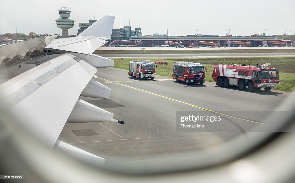 Fire trucks surround the plane of French-German delegation, German Foreign Minister Frank-Walter Steinmeier and French Foreign Minister Marc Ayrault after an aborted take-off on May 01, 2016 in Berlin, Germany. The plane of French-German delegation aborted take-off after a blowout.