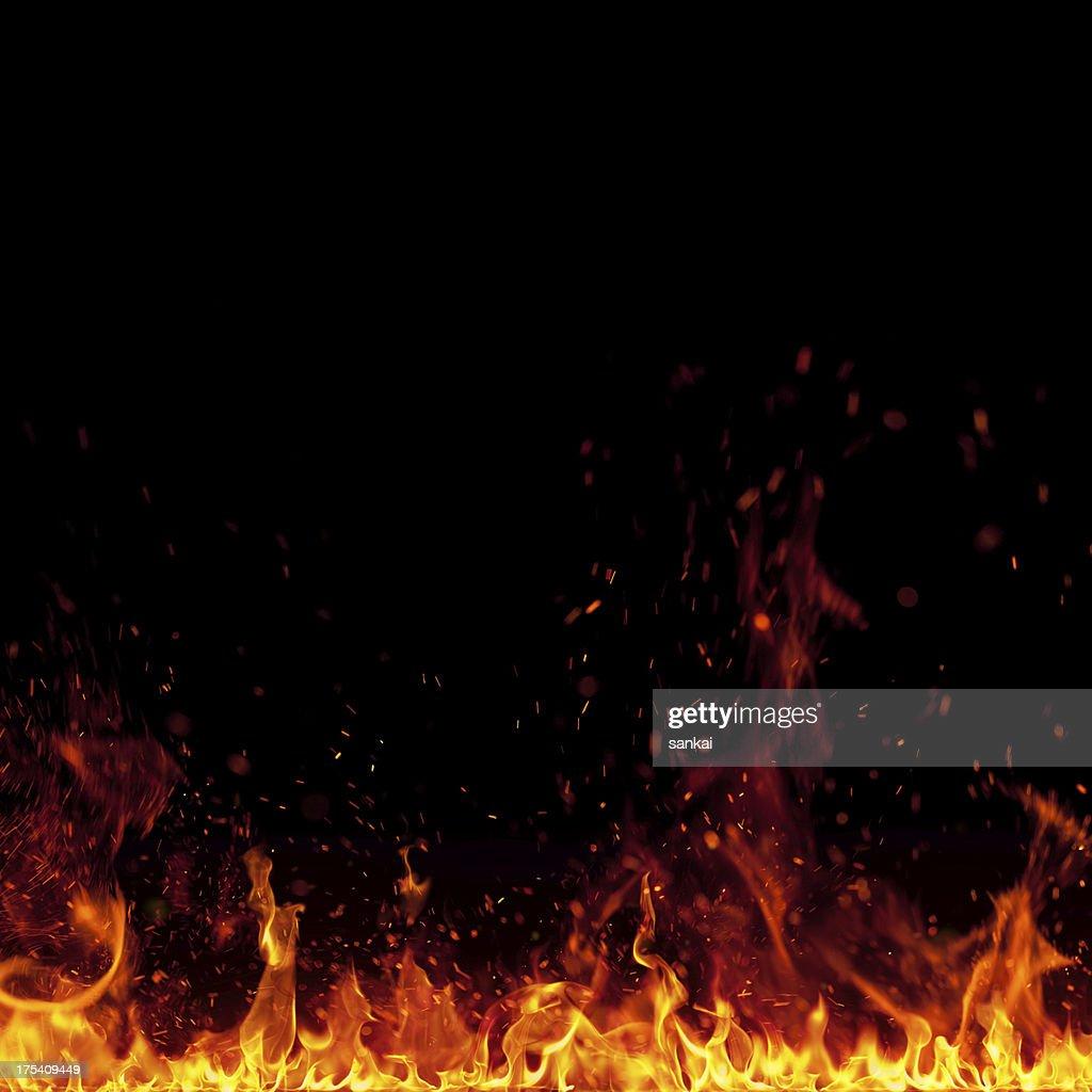 XXXL avec des étincelles de feu isolé sur fond noir : Photo