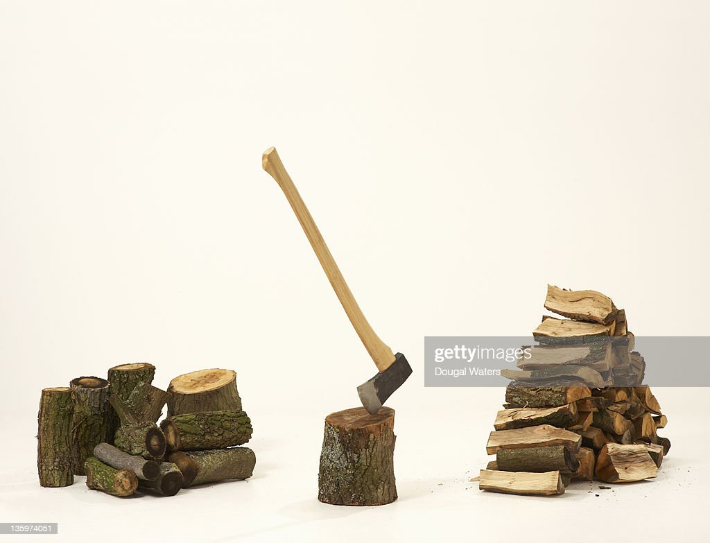 Fire wood and axe against white background. : Stock Photo
