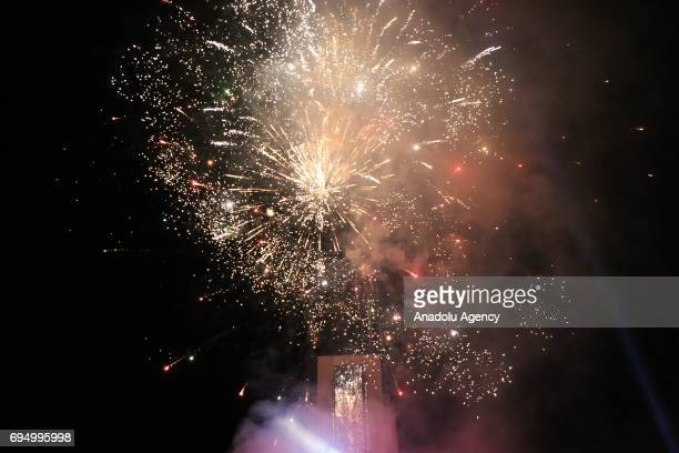 Fire works are set off as supporters of the PAN coalition celebrate their victory in Pristina Kosovo on early June 12 2017 After 90 percent of the...