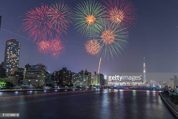 Fire works with Sky tree and skyscrapers in Tokyo