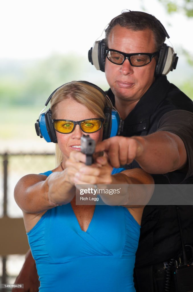 Firearm Instructor and Student : Stock Photo