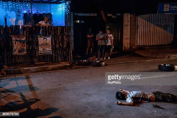 A firearm is seen next to body of a man who was shot dead by police after engaging in a shootout in Quezon city north of Manila Philippines February...