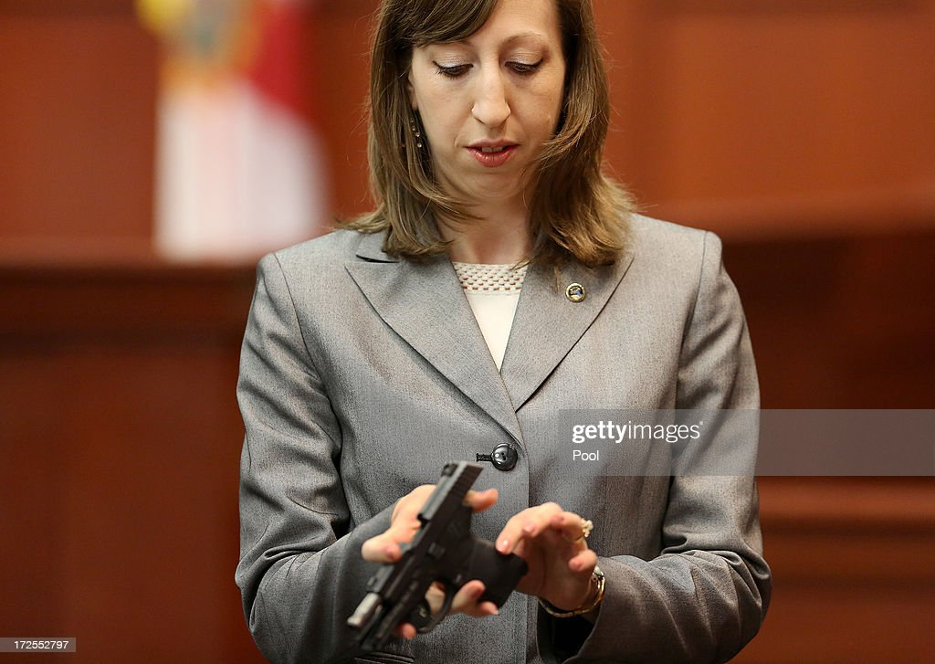 Firearms analyst Amy Siewert from Florida Department of Law Enforcement speaks to the jury while holding George Zimmerman's gun during the George Zimmerman trial in Seminole circuit court, July 3, 2013 in Sanford, Florida. Zimmerman is charged with second-degree murder for the February 2012 shooting death of 17-year-old Trayvon Martin.