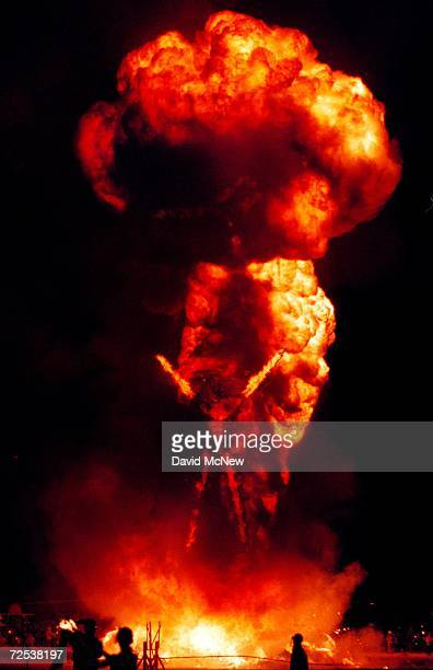 A fireball billows up from a 52foot tall wooden man as it goes up in flames September 2 2000 during the15th annual Burning Man festival in the Black...