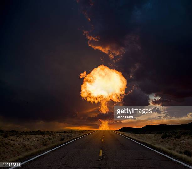 Fireball exploding over a long road.