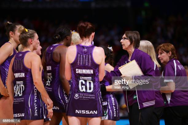 Firebirds coach Roselee Jencke talks to her players during a time out during the round 14 Super Netball match between the Giants and the Lightning at...
