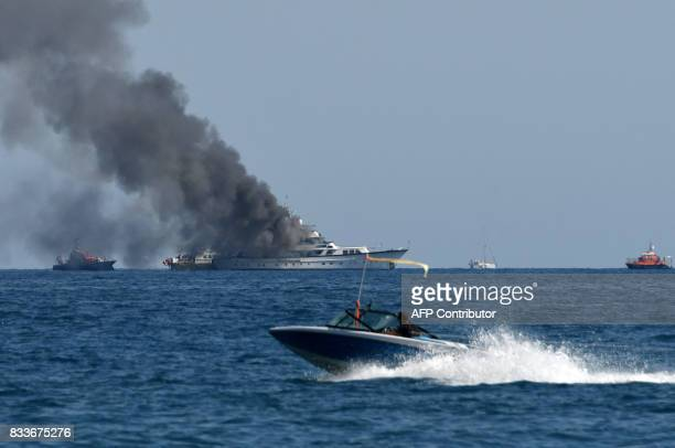 Fireboats approach as smoke rises from the boat 'If Only' a 39meterlong yacht that is on fire off SaintLaurentduVar near Nice southern France on...