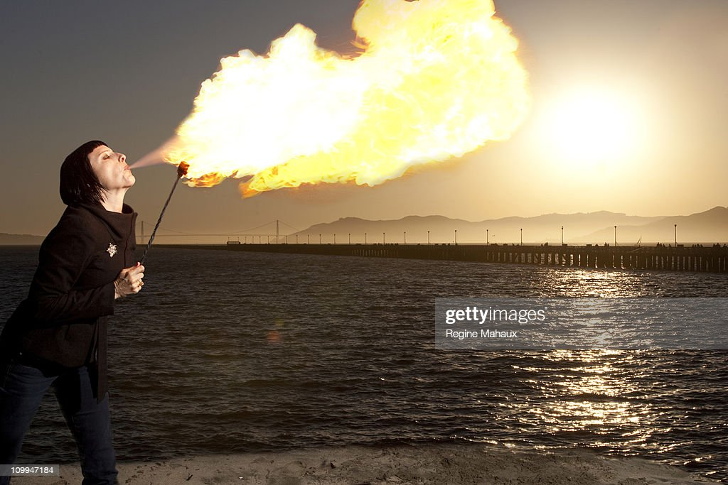Firebreather woman : Stock Photo