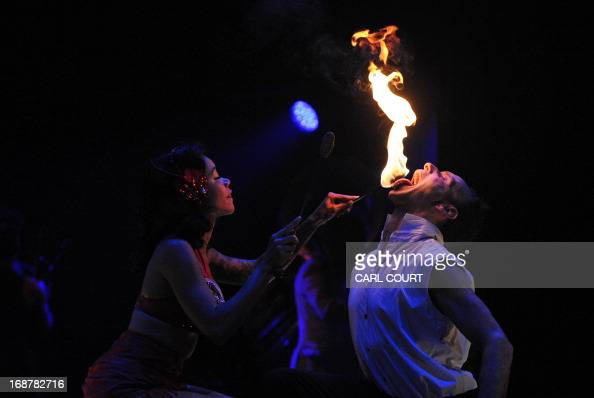 Firebreathers perform their part of the 'LIMBO' circus show in the temporary London Wonderground festival at the Southbank Centre in central London...