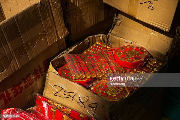 Firecracker decorations on sale for Lunar New Year sit in a box at a market stall in the Sham Shui Po district of Hong Kong China on Thursday Feb 4...