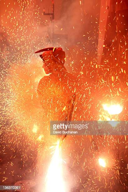 Firecracker exploding with devil in background