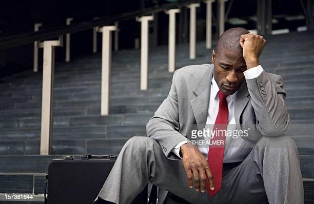 Fired businessman in total despair