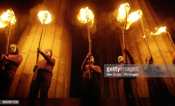 Firedancers stand guard on the Acropolis on the top of Calton Hill in Edinburgh as part of the Beltane fire festival