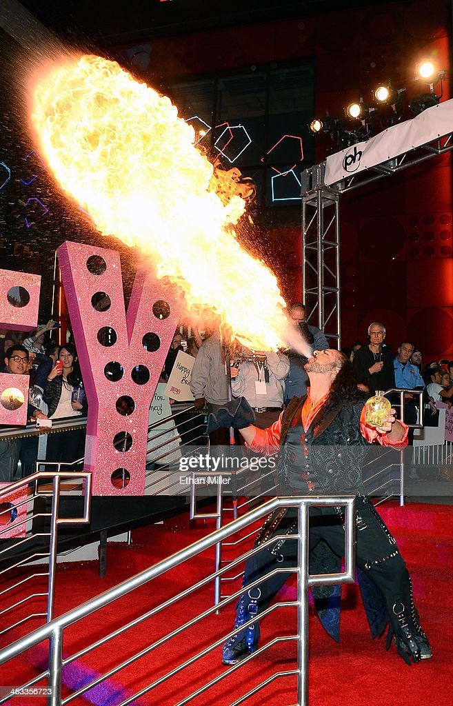 A fire-eater performs during a welcome ceremony for Britney Spears as she celebrates the release of her new album 'Britney Jean' and prepares for her two-year residency at Planet Hollywood Resort & Casino on December 3, 2013 in Las Vegas, Nevada. Spears' show 'Britney: Piece of Me' will debut at the resort on December 27, 2013.