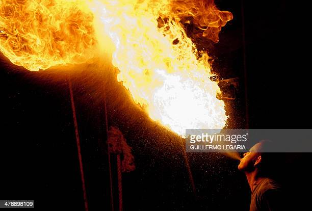A fireeater soldier spits a flame during a show of the Army's Colombia Circus in Tibirita Cundinamarca department Colombia on March 8 2014 Every show...