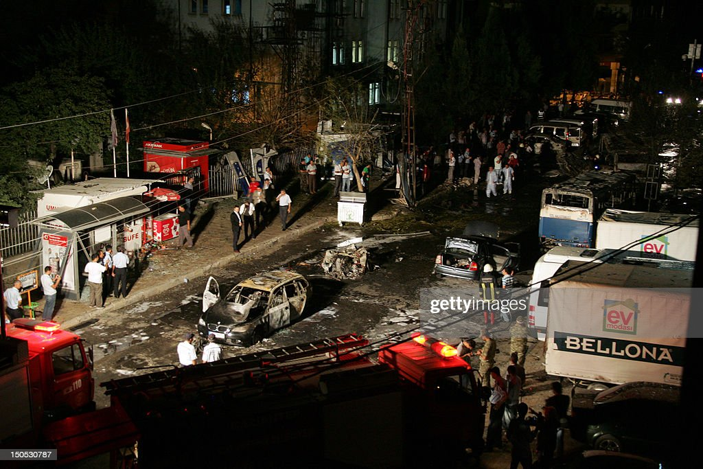 Firefighers and police surround the area where a car bomb went off on August 20 2012 in the centre of Gaziantep Turkey At least seven people were...