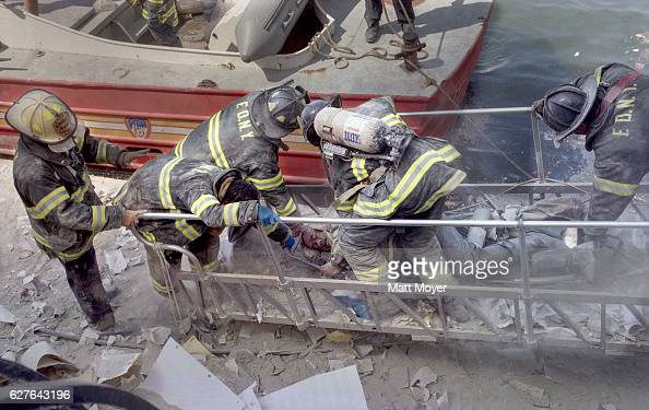 FDNY firefighter Al Fuentes is evacuated from a marina in lower Manhattan after he was injured in the collapse of the World Trade Center on Sept 11...