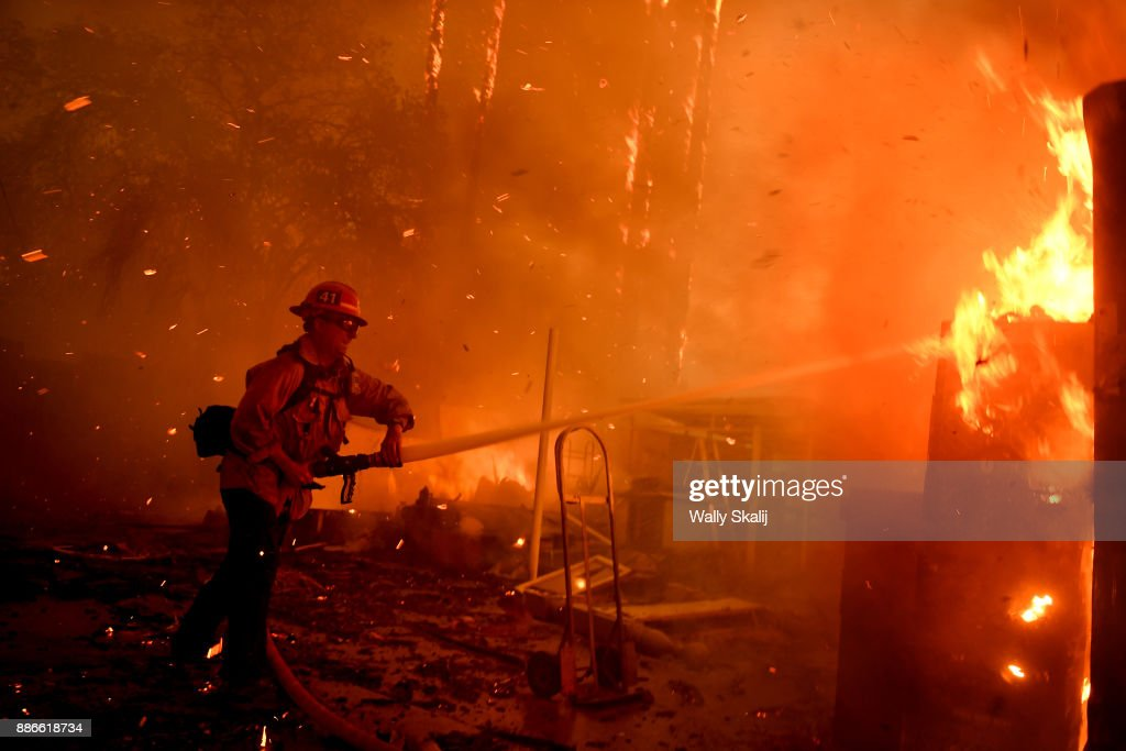 A firefighter battles the Thomas Fire along Highway 33 in Casita Springs in Ventura County Tuesday.