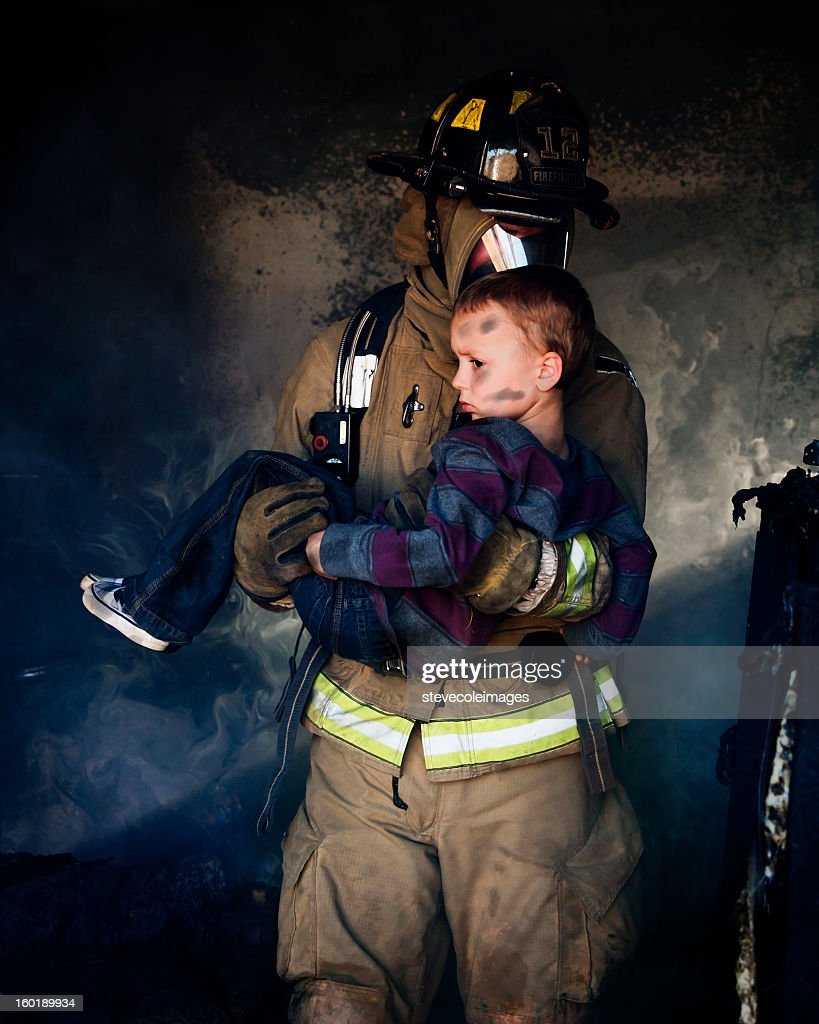 Firefighter Carrying Boy