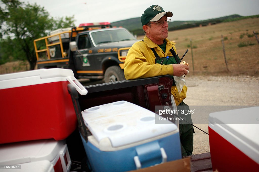 Firefighter, Chris Clear, with the Lone Camp volunteer fire department, takes a break from cutting fire lines on the 101 Ranch on April 20, 2011 in Palo Pinto, Texas. The area wildfires had calmed due to cooler tempratures, higher humidity, and calm winds overnight.