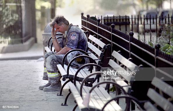 FDNY firefighter Dan Potter pauses on a bench in Lower Manhattan after the collapse of the World Trade Center on Sept 11 2001