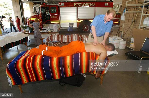 Firefighter Daniel Cross of the Ladysmith Fire Department on Vancouver Island gets a massage from therapist Matthew Longman after a day of fighting...