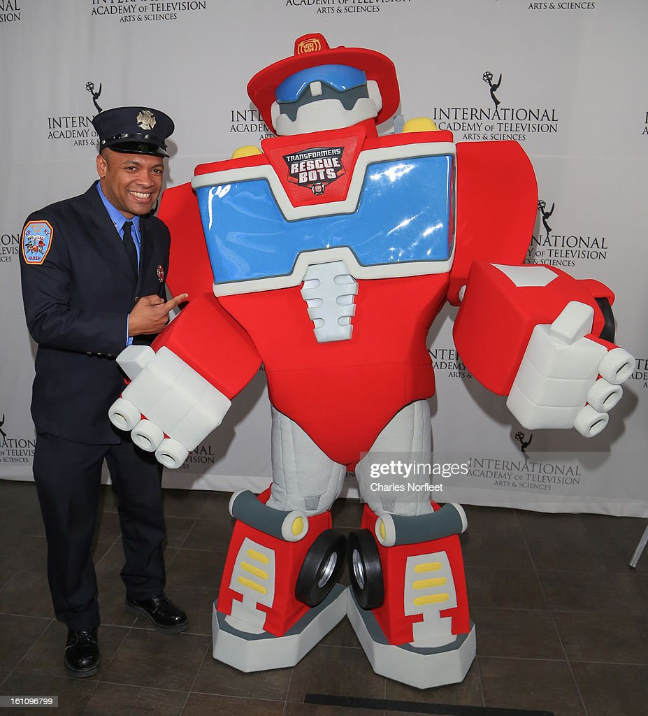 Firefighter Daniel Glover and Transformer Rescue Bot, Heatwave attend The Inaugural International Emmy Kids Awards at The Lighthouse at Chelsea Piers on February 8, 2013 in New York City.