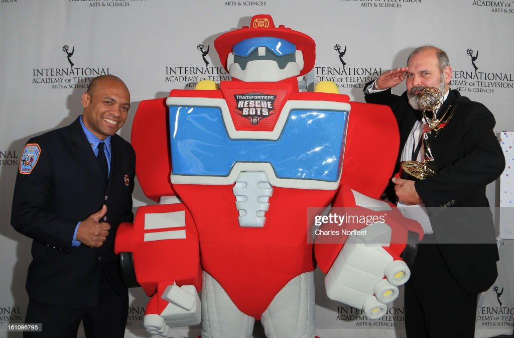 Firefighter Daniel Glover, Transformer Rescue Bot, Heatwave, and British Television Executive Producer Michael Carrington with the Kids: Animation Emmy Award for 'The Amazing Wold Of Gumball' attend The Inaugural International Emmy Kids Awards at The Lighthouse at Chelsea Piers on February 8, 2013 in New York City.