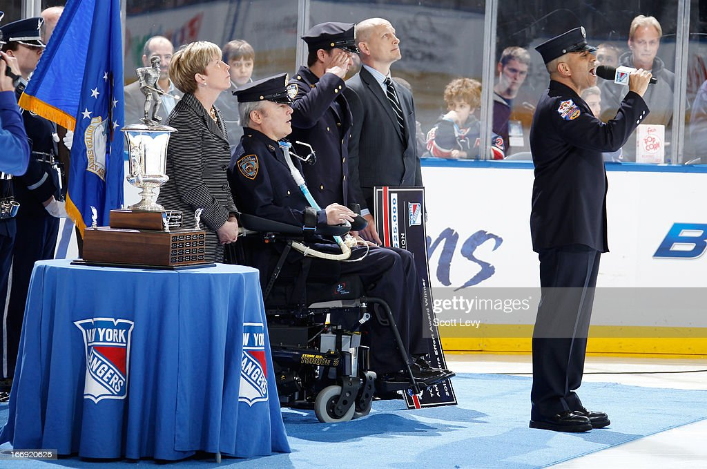 FDNY firefighter Frank Pizarro sings the national anthem after the presentation of the Steven McDonald Extra Effort Award prior to the New York Rangers game against the Florida Panthers at Madison Square Garden on April 18, 2013 in New York City.