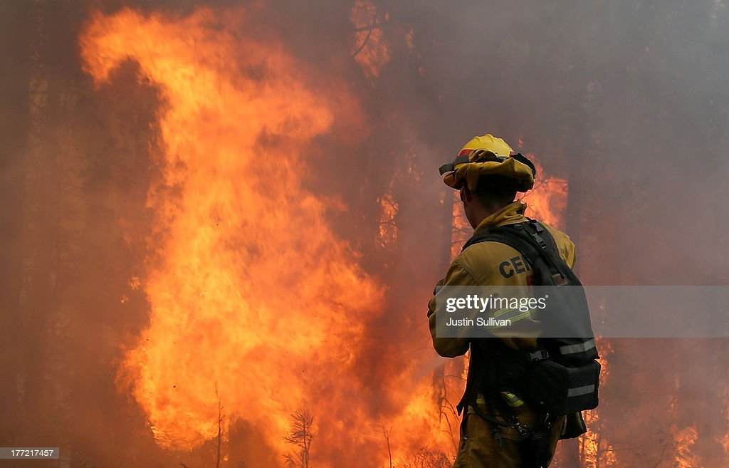 A firefighter from Central Calaveras Fire monitors the Rim Fire on August 22, 2013 in Groveland, California. The Rim Fire continues to burn out of control and threatens 2,500 homes outside of Yosemite National Park. Over 1,000 firefighters are battling the blaze that was reduced to only 2 percent containment after it nearly tripled in size overnight.