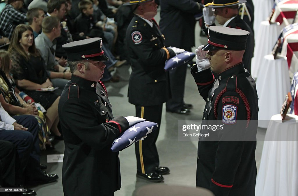 A firefighter honor guard prepares to hand over the American flags to family members of the twelve fallen volunteer firefighters at the West memorial service at Baylor University on April 25, 2013 in Waco, Texas. The memorial service honored the volunteer firefighters that lost their lives at the fertilizer plant explosion in West, Texas last week.
