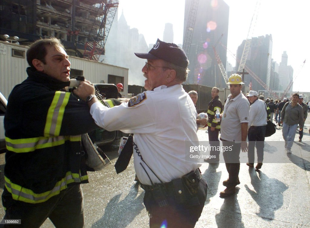 A firefighter is arrested during a rally near the collapse zone of the World Trade Center November 2, 2001 in New York City. Several hundred firefighters rallied against the Mayor's plan to scale back the role of the fire department in the recovery effort.
