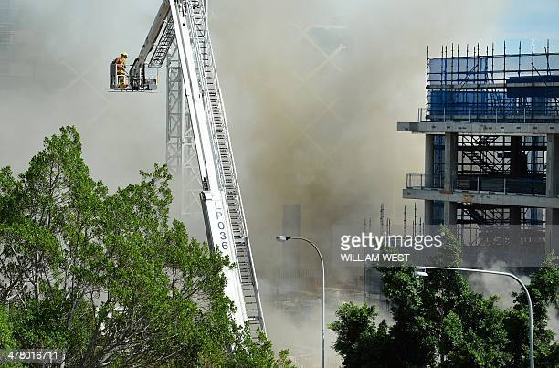 A firefighter looks down on the site of a fire at the Barangaroo construction site which threw plumes of smoke over Sydney's central business...