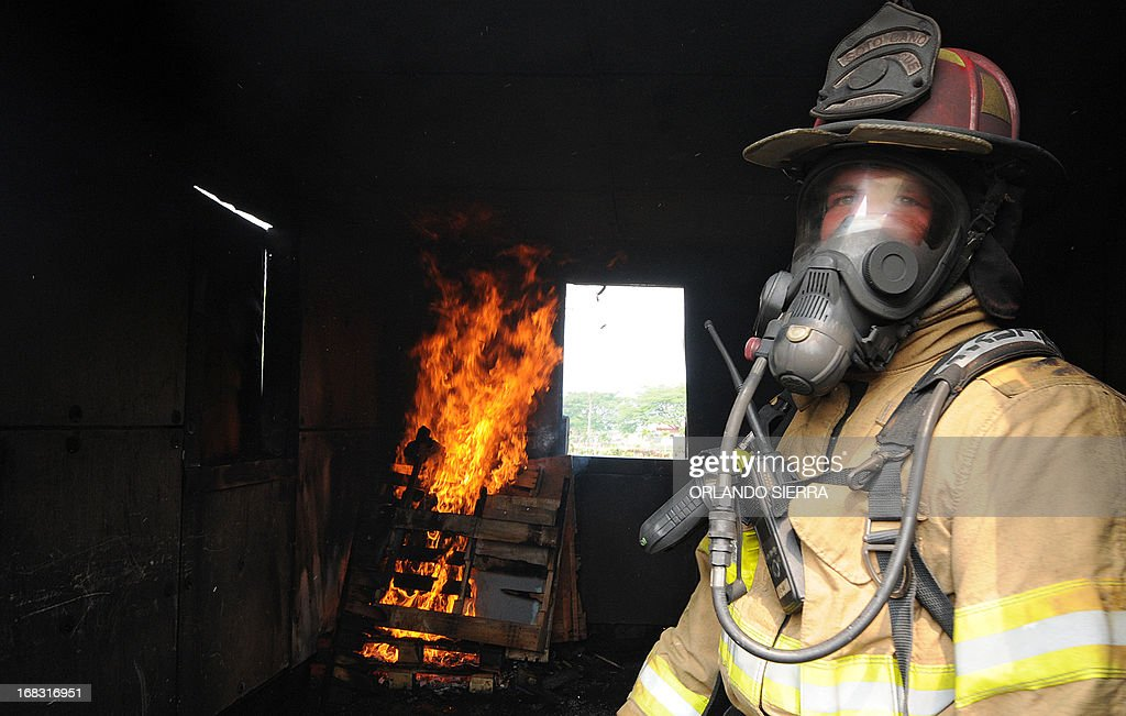 A firefighter looks on during a training session at Palmerola US military base, 80 kms north of Tegucigalpa, on May 8, 2013. Firefighters from Honduras, Nicaragua, Panama, Guatemala, Belize and El Salvador received specialized training from US firefighters. AFP PHOTO/Orlando SIERRA