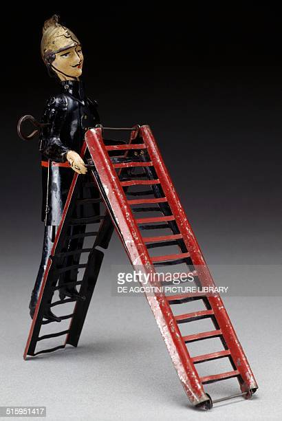 Firefighter on a ladder toy with spring mechanism made by Jouets Martin France 19th century Milan Museo Del Giocattolo E Del Bambino