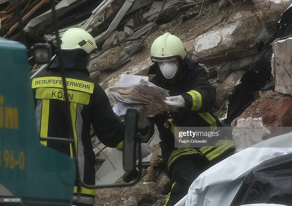 A firefighter passes over documents to his colleague at the ruine of the building of the Historical Archive of the City of Cologne in the Severinstrasse after its collapse on Tuesday due to until yet unknown reasons on March 6, 2009 in Cologne, Germany. Cologne's six-story city archive building groaned then collapsed in a pile of rubble as people inside fled in panic. The archive building collapsed about 2 p.m., ripping open and dragging down parts of two adjacent buildings that contained apartments and an amusement arcade. Cologne holds archive material going back over centuries, including manuscripts by communist pioneers Karl Marx and Friedrich Engels and documents related to German writer Heinrich Boell.
