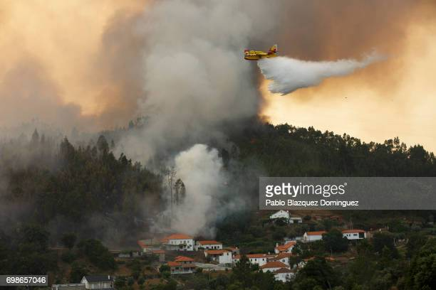 A firefighter plane battles a fire after a wildfire took dozens of lives on June 20 2017 in Mega Fundeira village near Picha in Leiria district...