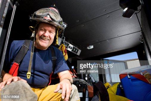 Firefighter Portrait In Fire Engine