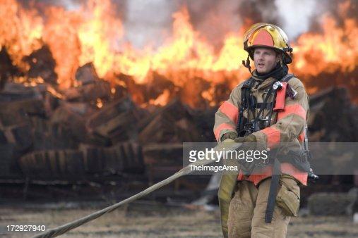 Firefighter pulling hose