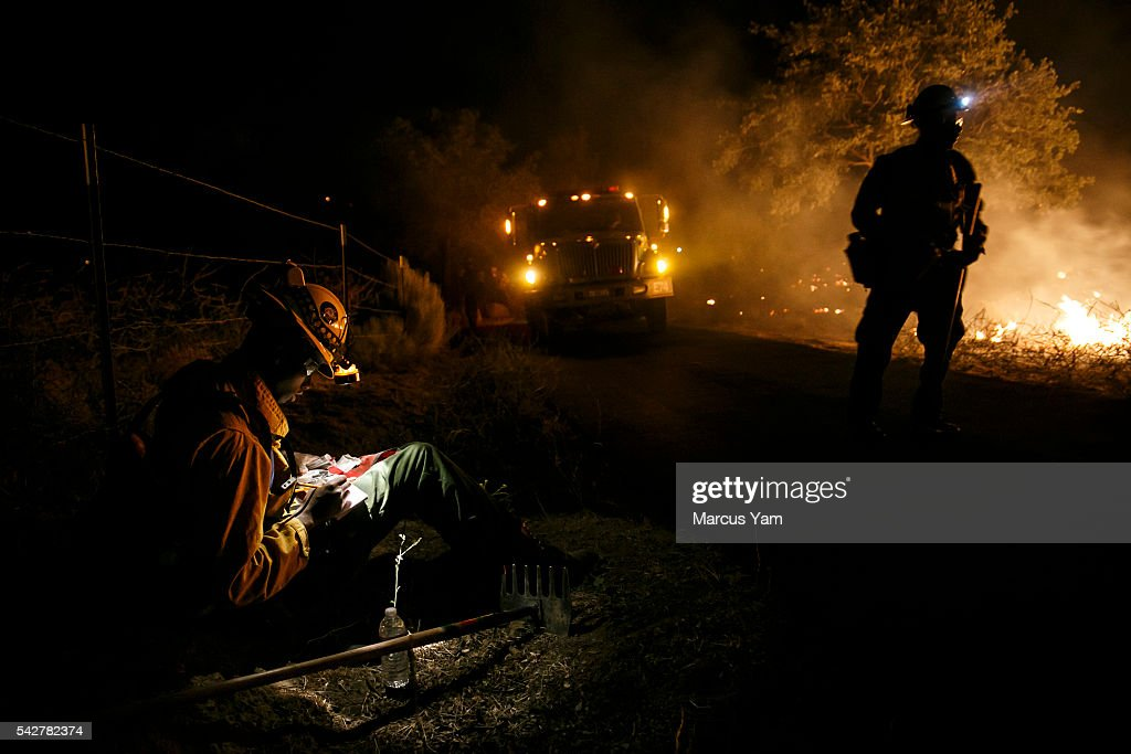 A firefighter records topographical data as they perform a firing operation in Lake Isabella, Calif., on June 24, 2016.