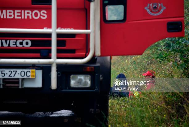 A firefighter rests close to the village of Aguda on June 19 2017 More than 1000 firefighters are still trying to control the huge forest fire that...