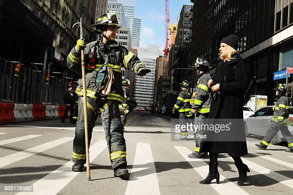 A firefighter secures a road after scaffolding became loose due to high winds on February 13 2017 in New York City Dozens of firefighters responded...