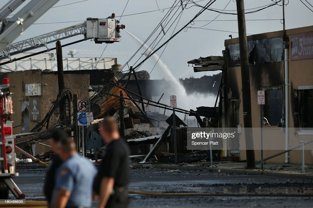 A firefighter sprays water on a hot-spot at the scene of a massive fire that destroyed dozens of businesses along an iconic Jersey shore boardwalk on September 13, 2013 in Seaside Heights, New Jersey. The 6-alarm fire began in a frozen custard stand on the recently rebuilt boardwalk around 2:00 p.m. on Thursday, September 12, and quickly spread in high winds. While there were no injuries reported, many businesses that had only recently re-opened after Hurricane Sandy were destroyed in the blaze.