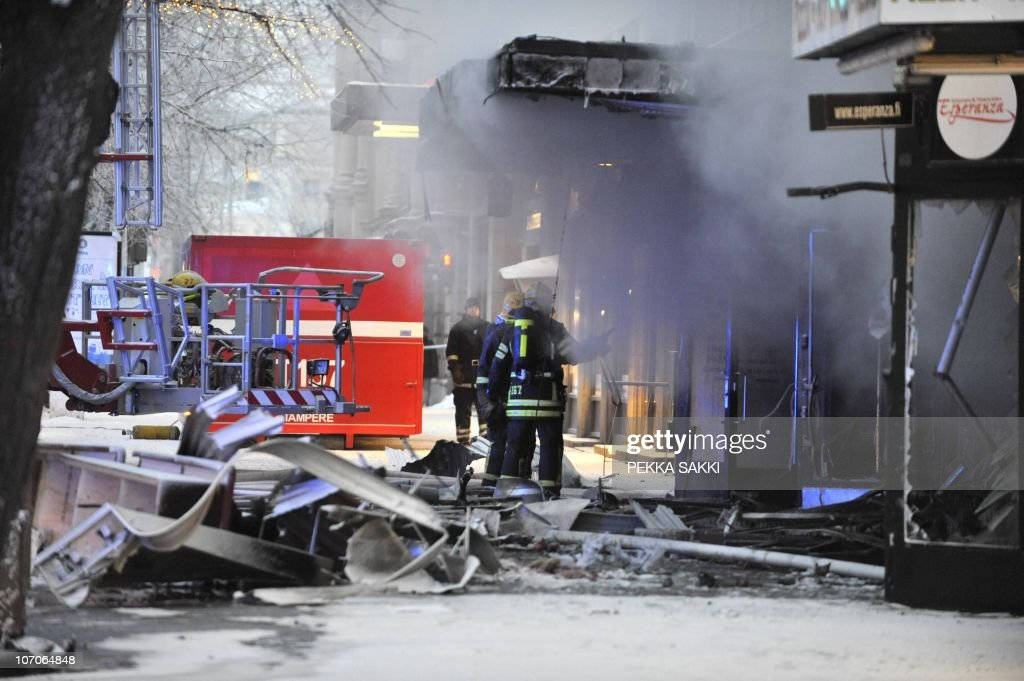 A firefighter stands in front of an apartment building early on November 22, 2010 after a fire broke out in a restaurant on the ground floor of the building in the center of the southern city of Tampere, killing three people and injuring four others. All the bodies were found in the staircase of the building. Forty-one persons were evacuated.