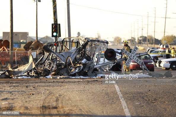 A firefighter stands in the intersection where a Metrolink train colliding with a vehicle on the tracks after colliding with a vehicle on the tracks...