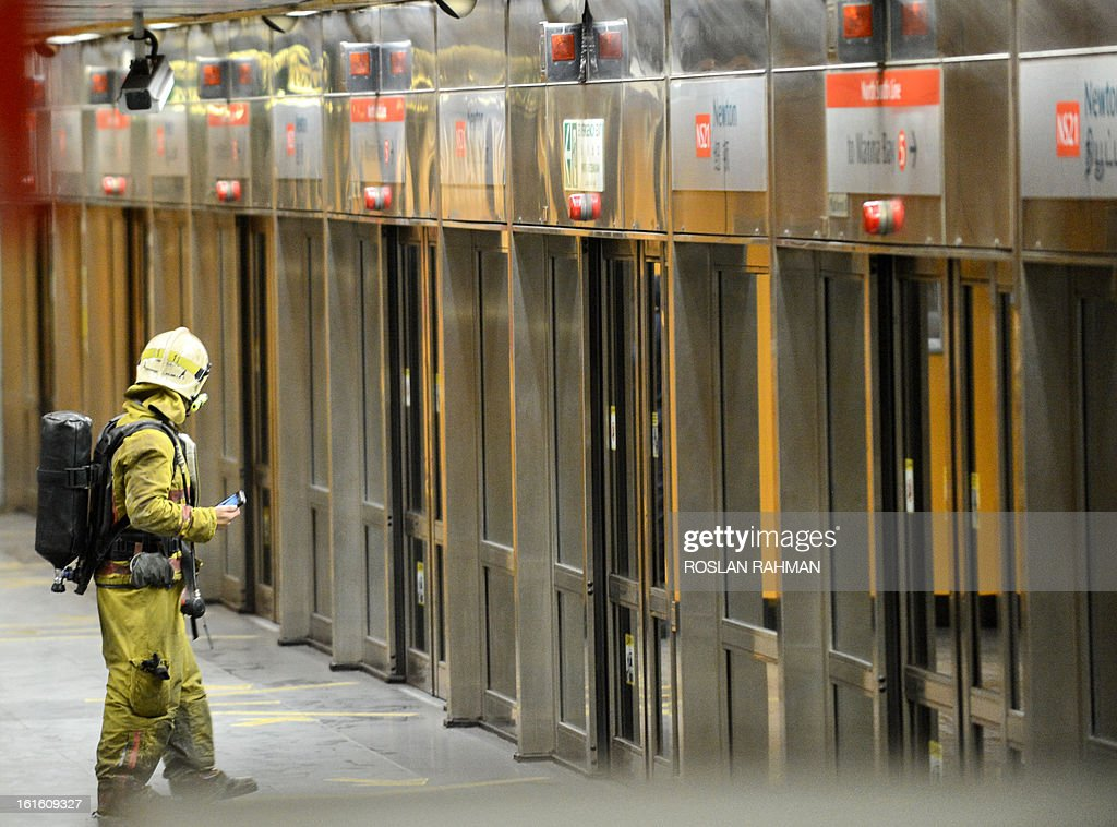 A firefighter stands in the subway platform at Newton station in Singapore on February 13, 2013. An electrical fire at an underground train station disrupted metro services in Singapore but it was quickly put under control and no injuries were reported, authorities said. AFP PHOTO / ROSLAN RAHMAN